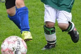 Muddy Soccer Player Legs